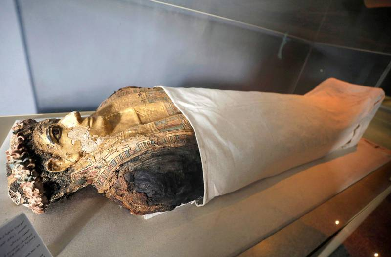 A mummy dated back to the Greco-Roman Period, discovered in a cemetery, is seen displayed in Bahariya Oases near village of Bawity, Egypt March 20, 2021. REUTERS/Mohamed Abd El Ghany REFILE - CORRECTING LOCATION