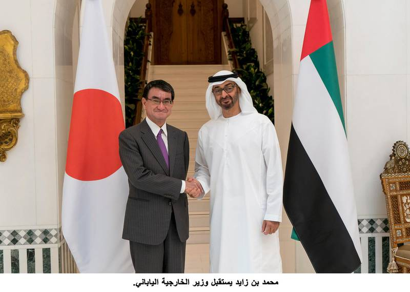 ABU DHABI, UNITED ARAB EMIRATES - December 10, 2017: HH Sheikh Mohamed bin Zayed Al Nahyan Crown Prince of Abu Dhabi Deputy Supreme Commander of the UAE Armed Forces (R), stands for a photograph with Taro Kono, Minister of Foreign Affairs of Japan (L), at the Sea Palace.( Rashed Al Mansoori / Crown Prince Court - Abu Dhabi )---
