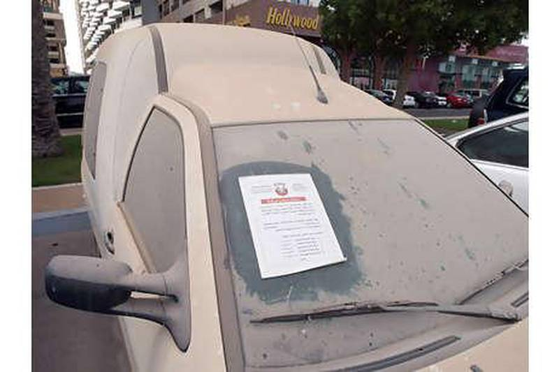 United Arab Emirates - Abu Dhabi - August 6 - 2008: Abandoned vehicle  in public parking area tagged by the Municipality of the city of Abu Dhabi. (Manuel Salazar/The National)
