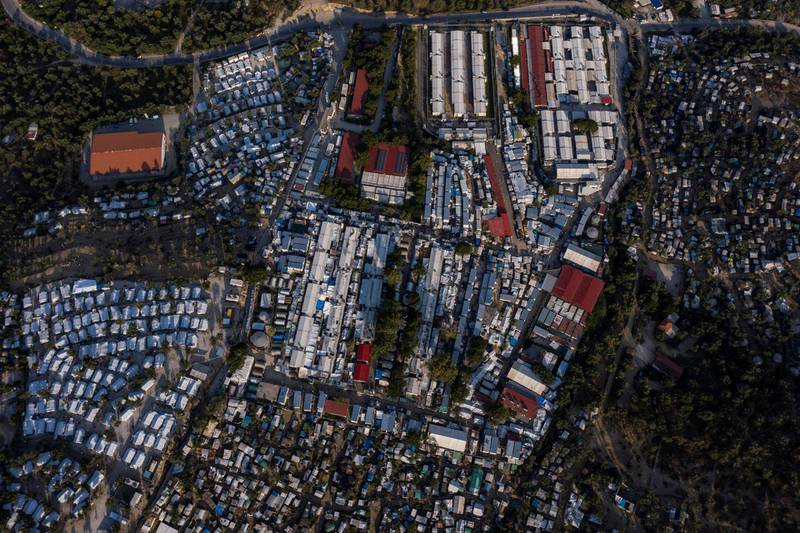 This picture taken on June 21, 2020 shows an improvised tents camp around the refugee camp of Moria in the island of Lesbos. - Greece's announcement that it was extending the coronavirus lockdown at its migrant camps until July 5, cancelling plans to lift the measures on June 22, coincided with World Refugee Day on June 27, 2020. (Photo by ARIS MESSINIS / AFP)