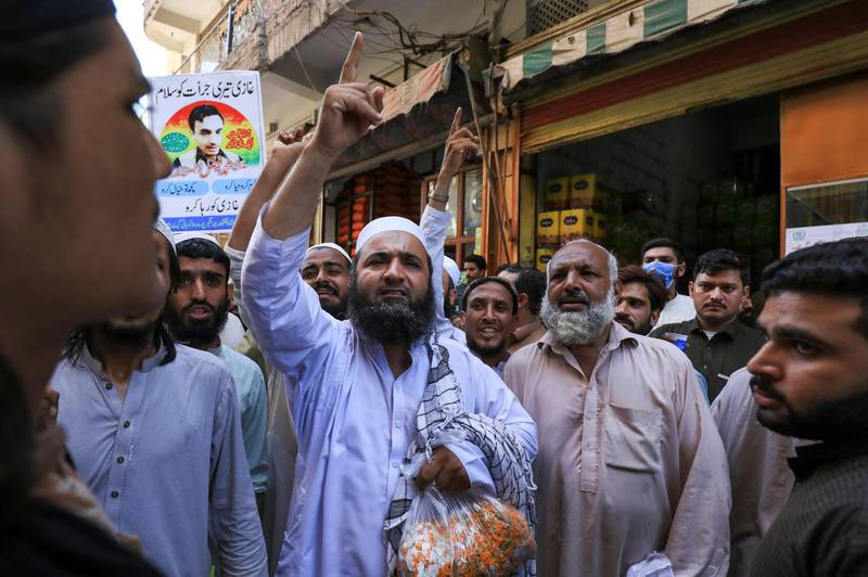 People chant slogans in favour of a man who, according to the Pakistani police, is suspected of killing U.S. national Tahir Ahmed Naseem during a proceeding at a judicial complex, in a protest rally demanding his release, in Peshawar, Pakistan August 5, 2020. Picture taken August 5, 2020. REUTERS/Fayaz Aziz