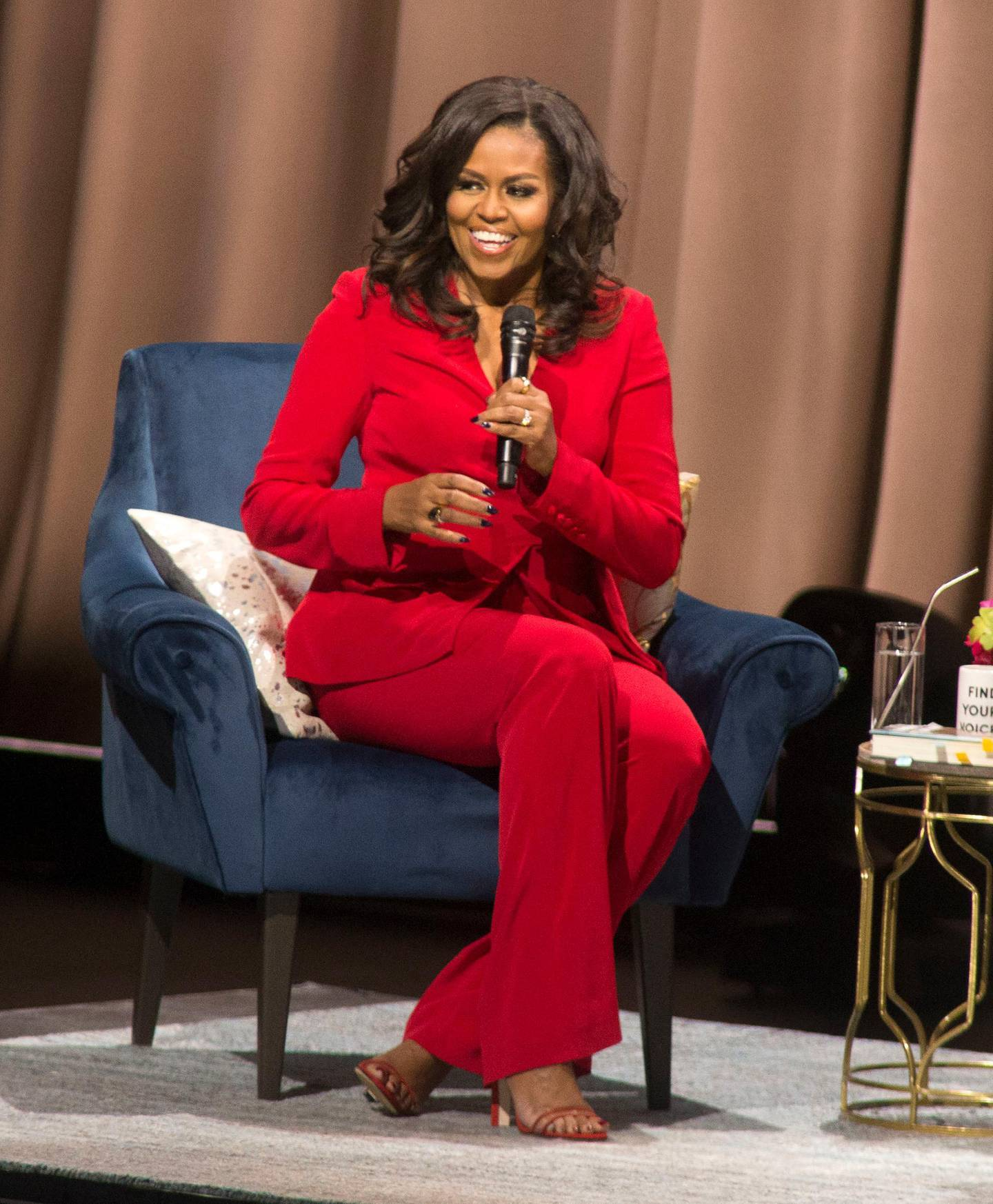 """Former first lady Michelle Obama speaks at the """"Becoming: An Intimate Conversation with Michelle Obama"""" event at the Wells Fargo Center on Thursday, Nov. 29, 2018, in Philadelphia. (Photo by Owen Sweeney/Invision/AP)"""