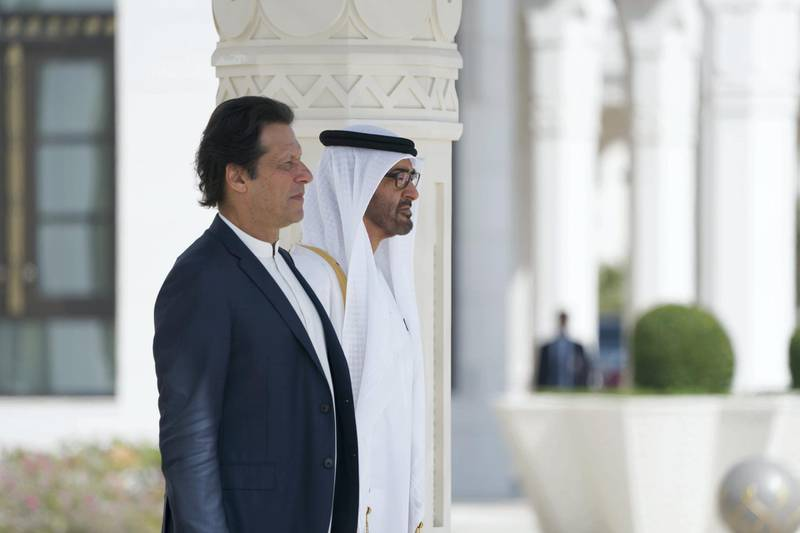 ABU DHABI, UNITED ARAB EMIRATES - November 18, 2018: HH Sheikh Mohamed bin Zayed Al Nahyan Crown Prince of Abu Dhabi Deputy Supreme Commander of the UAE Armed Forces (R) and HE Imran Khan, Prime Minister of Pakistan (L), stand for the national anthem, during a reception held at the Presidential Palace.  ( Mohamed Al Hammadi / Ministry of Presidential Affairs ) ---