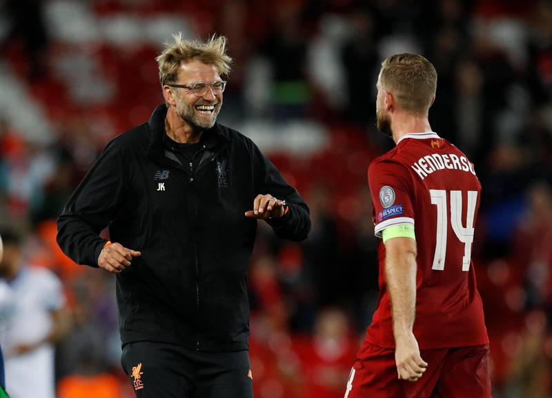 Soccer Football - Champions League - Playoffs - Liverpool vs TSG 1899 Hoffenheim - Liverpool, Britain - August 23, 2017   Liverpool manager Juergen Klopp and Jordan Henderson celebrate after the match    REUTERS/Phil Noble
