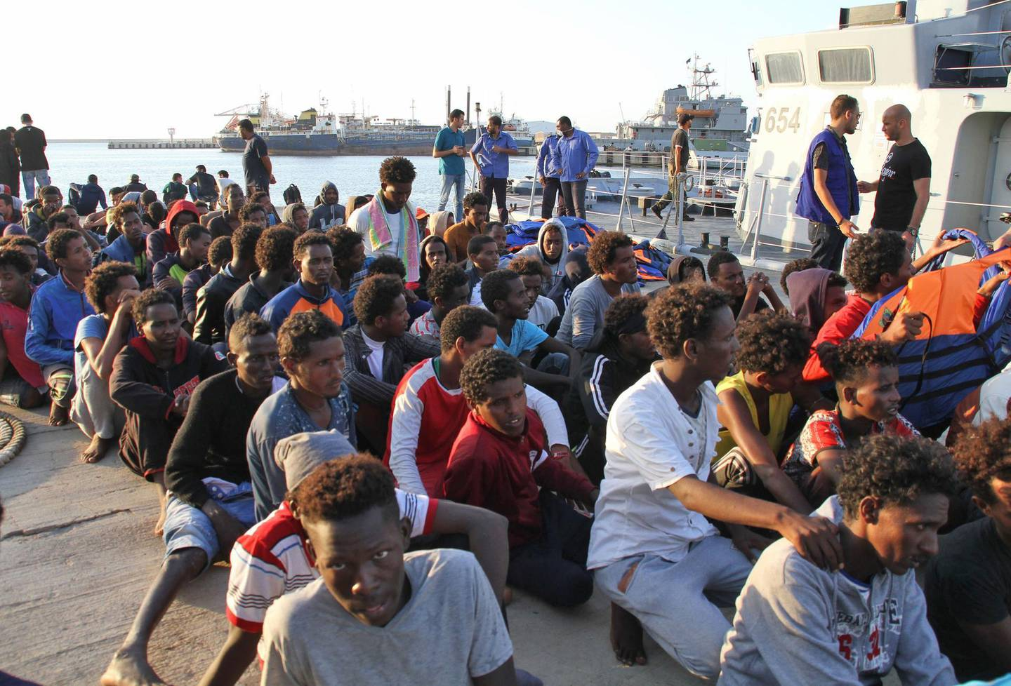 African migrants, who according to the Libyan navy were rescued by the country's coast guard, arrive at the naval base of the capital Tripoli on July 12, 2018.  / AFP / STRINGER