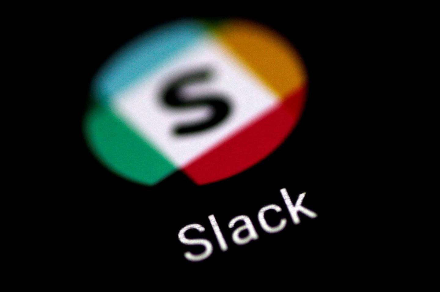 FILE PHOTO: The Slack messaging application is seen on a phone screen August 3, 2017.   REUTERS/Thomas White/File Photo