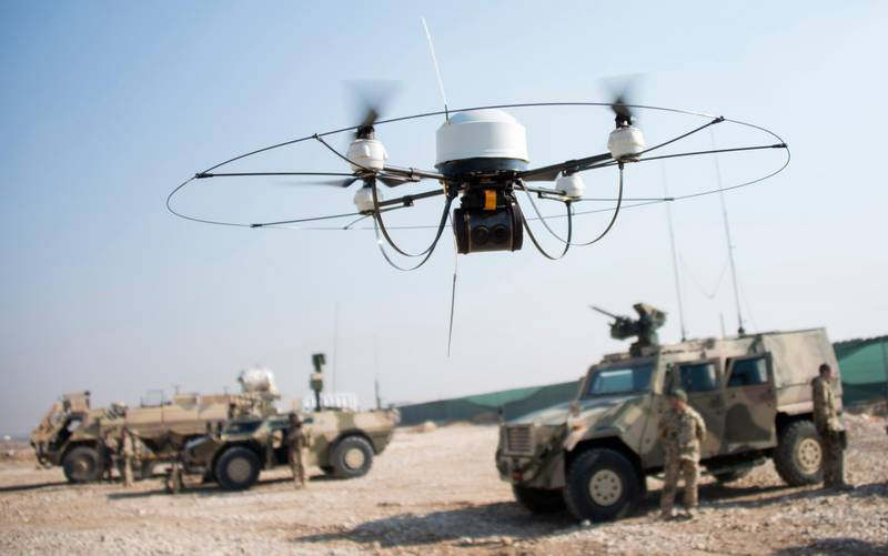 A Mikado drone of the Bundeswehr flies during a show of  German soldiers at Camp Marmal in Mazar-e-Sharif on December 23, 2013.  About 3,000 German troops are deployed in Afghanistan, where the country is the lead nation in the relatively peaceful northern region. AFP PHOTO/JOHANNES EISELE (Photo by JOHANNES EISELE / AFP)