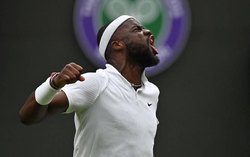 TOPSHOT - US player Frances Tiafoe celebrates breaking serve against Greece's Stefanos Tsitsipas during their men's singles first round match on the first day of the 2021 Wimbledon Championships at The All England Tennis Club in Wimbledon, southwest London, on June 28, 2021.  - RESTRICTED TO EDITORIAL USE  / AFP / Ben STANSALL / RESTRICTED TO EDITORIAL USE