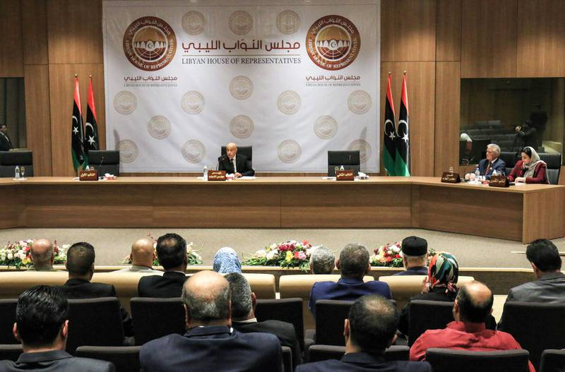 Aguila Saleh Issa (C), speaker of Libya's fomerly-Tobruk-based House of Representatives which was elected in 2014, chairs the first session for the assembly at its new headquarters in the second city of Benghazi in the eastern part of the country controlled by strongman Khalifa Haftar, on April 13, 2019.  / AFP / Abdullah DOMA