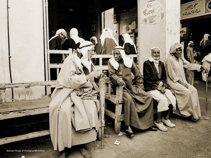Old men on a bench are Bahraini men discussing daily matters in one of Muharraq's coffee shops, 1960s.  Courtesy National Center for Documentation and Research.