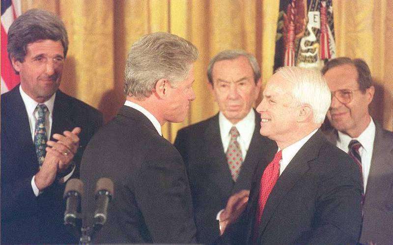 US President Bill Clinton (2nd-L) talks to Senator John McCain (2nd-R) after announcing that the US is establishing normal relations with  communist Vietnam as Senator Bob Kerrey (L) D-NE  Secretary of State Warren Christopher (C) and Defense Secretary William Perry (R) look on during ceremonies at the White House in Washington, DC 11 July. Clinton pledged that the US would continue to press for a full accounting of more than 2,200 servicemen still listed as missing in Vietnam and neighboring countries.              AFP PHOTO / AFP PHOTO / JOYCE NALTCHAYAN