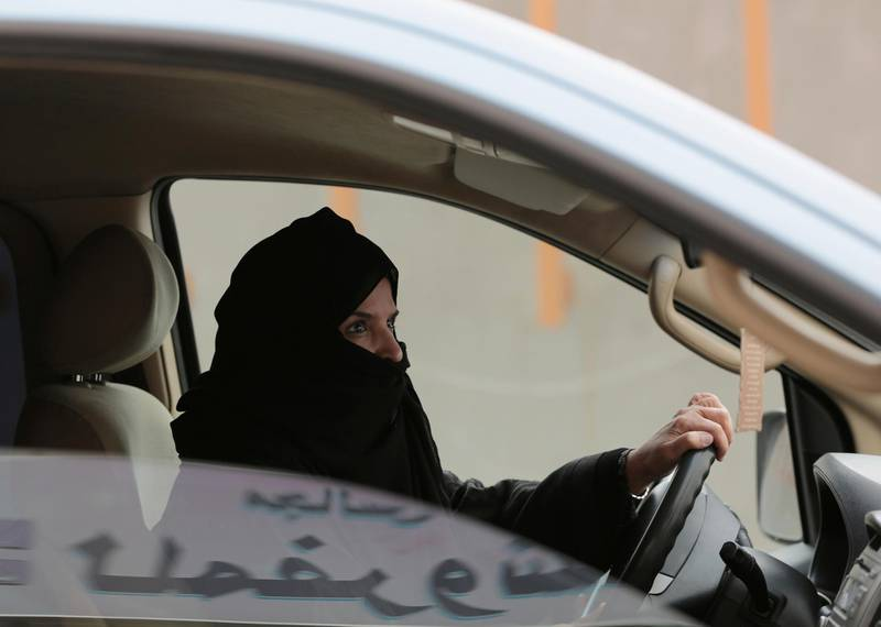 FILE - In this Saturday, March 29, 2014 file photo, Aziza Yousef drives a car on a highway in Riyadh, Saudi Arabia, as part of a campaign to defy Saudi Arabia's ban on women driving.  Saudi Arabia says it will allow women to drive for the first time in the ultra-conservative kingdom. The kingdom, which announced the change on Tuesday, Sept. 26, 2017, was the only the country in the world to bar women from driving and for years had garnered negative publicity internationally for detaining women who defied the ban. (AP Photo/Hasan Jamali, File)