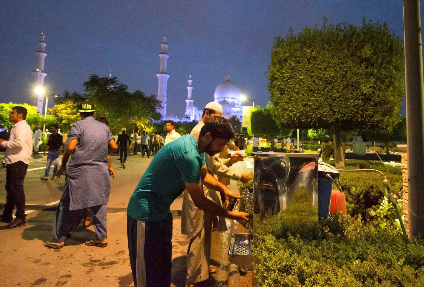 ABU DHABI, UNITED ARAB EMIRATES, 17 May 2018 -People washing their hands after breaking their fast at Sheikh Zayed Grand Mosque, Abu Dhabi. Leslie Pableo for The National