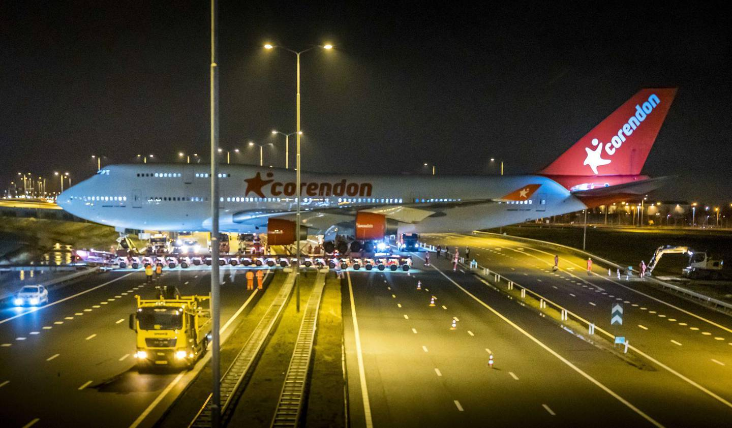 epa07355824 A fully stripped Boeing 747 of the airline Corendon is transported over the A9 highway, Badhoevedorp. the Netherlands, 09 February 2019. The jumbo jet is transported on a trailer from the airport to a hotel where it will become a hotel attraction.  EPA/LEX VAN LIESHOUT