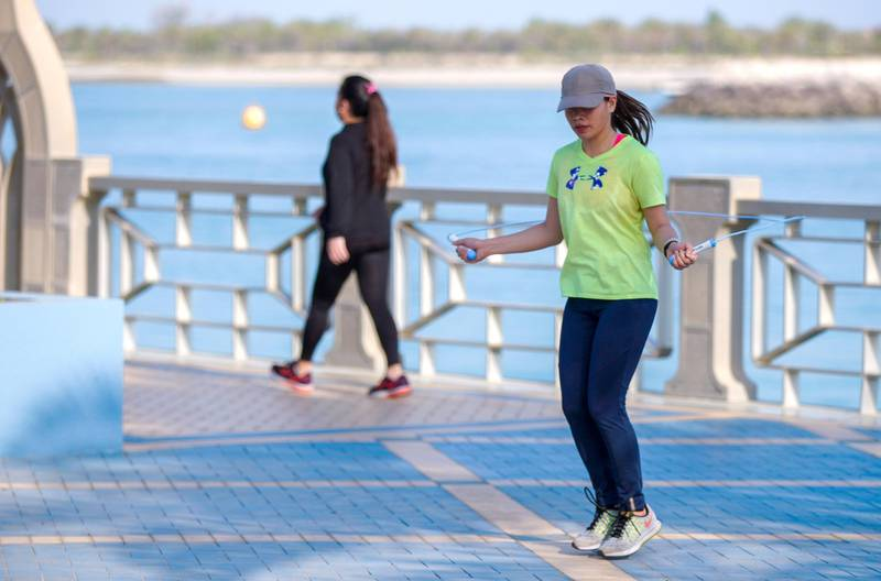 Abu Dhabi, United Arab Emirates, June 24, 2020.   FOR:  Standalone / Stock Images-- An Abu Dhabi resdent jump ropes along the corniche during the Covid-19 pandemic.Victor Besa  / The NationalSection:  NAReporter:  none