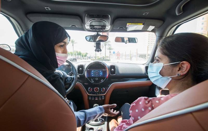 Dubai, United Arab Emirates - Instructor Sabia teaching a students pointers in driving at the Emirates Driving Institute, Dubai.  Leslie Pableo for The National