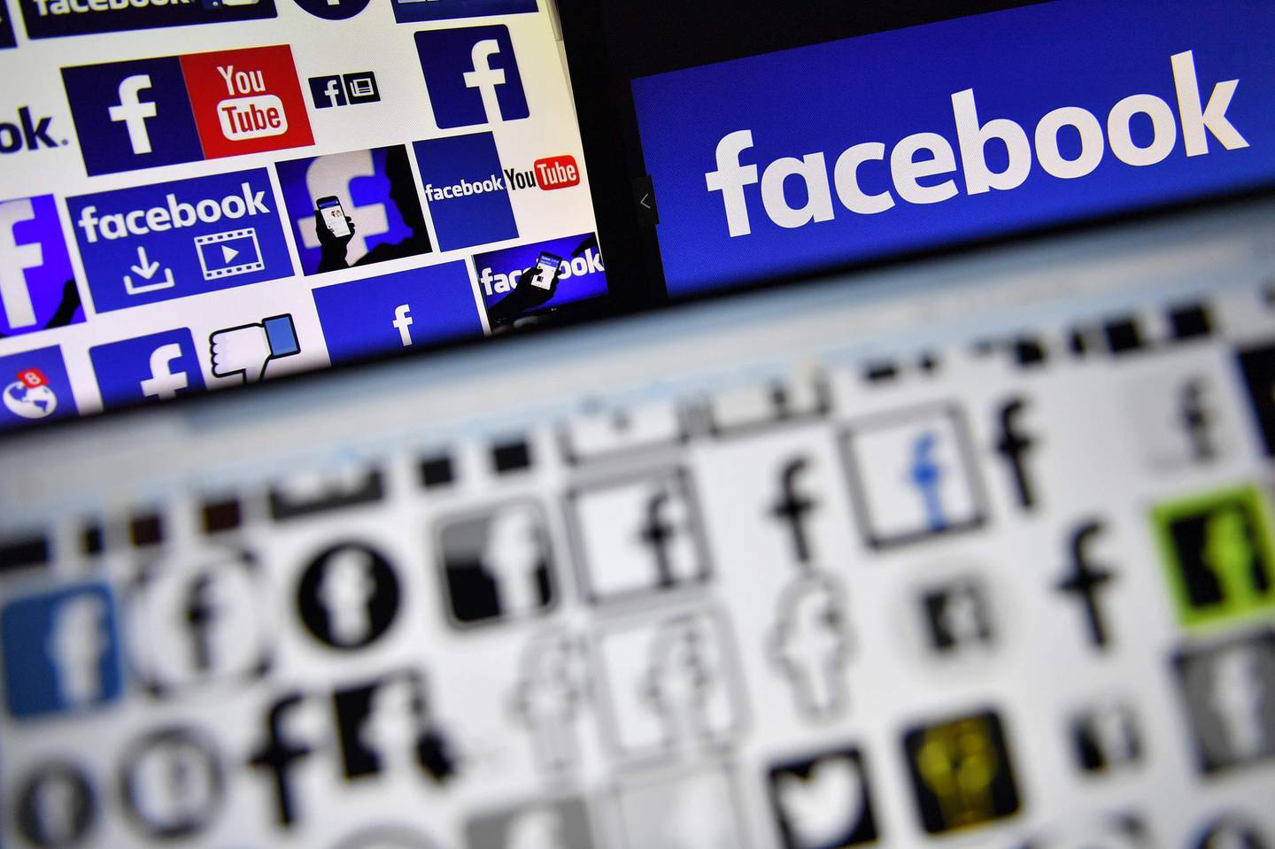 (FILES) This file photo taken on November 20, 2017 shows logos of US online social media and social networking service Facebook. Facebook announced on May 24, 2018 it will apply to its users accross the world the EU's General Data Protection Regulation (GDPR). The GDPR, which comes into effect on May 25, 2018, aims to give users more control over how their personal information is stored and used online, with big fines for firms that break the rules.  / AFP / LOIC VENANCE