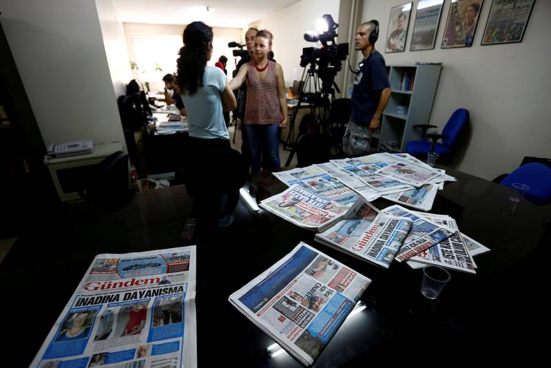 FILE PHOTO: A journalist of pro-Kurdish Ozgur Gundem gives an interview to a German TV channel at their newsroom before a protest against the arrest of three prominent campaigners for press freedom, in front of the pro-Kurdish Ozgur Gundem newspaper in central Istanbul, Turkey, June 21, 2016. REUTERS/Murad Sezer/File Photo