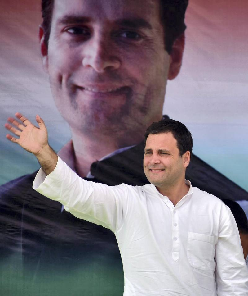 President of the Indian National Congress Committee party Rahul Gandhi waves to supporters during an election rally ahead of the Meghalaya state assembly election at Mendipathar on February 20, 2018. (Photo by Kulendu Kalita / AFP)