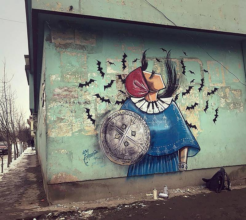 One of Shamsia Hassani's 2019 work on a Kabul wall. Musical instruments are a common theme in her work which signify women's need to use tools other than their voices to be heard. Picture courtesy of Shamsia Hassani