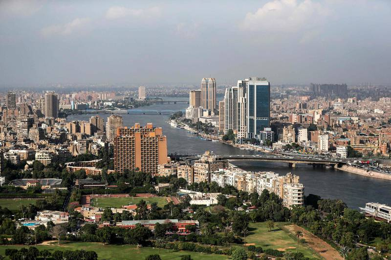 This picture taken on October 23, 2019 from the Cairo Tower in the centre of the Egyptian capital shows a view of the Nile river flowing through the city between the central downtown (R) and Zamalek (L) districts.  / AFP / Mohamed el-Shahed