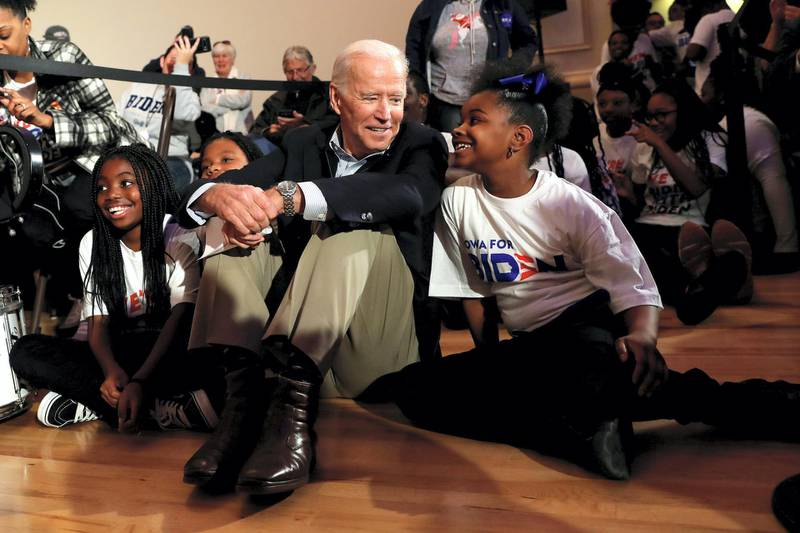 Democratic 2020 U.S. presidential candidate and former U.S. Vice President Joe Biden sits with kids from the Union Baptist Crusaders drill team during an event at the Brown Derby Ballroom in Waterloo, Iowa, U.S., December 5, 2019.  REUTERS/Shannon Stapleton     TPX IMAGES OF THE DAY