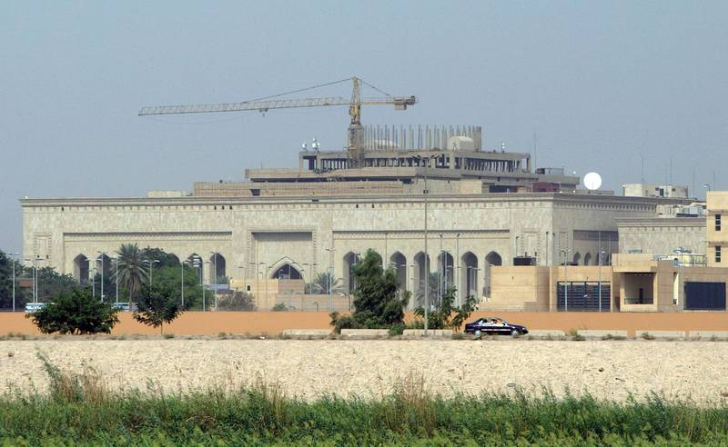 This file photo taken on October 11, 2007 shows in the forefront the US embassy complex in Baghdad and in the background, cranes towering over the construction site of the International High Tribunal (IHT) courthouse, in the heavily fortified Green Zone, on the west bank of the Tigris River in Baghdad. A volley of rockets exploded near the US embassy in Baghdad on December 20,2020, as tensions mount ahead of the anniversary of the US killing of top Iranian general Qasem Soleimani. / AFP / STR