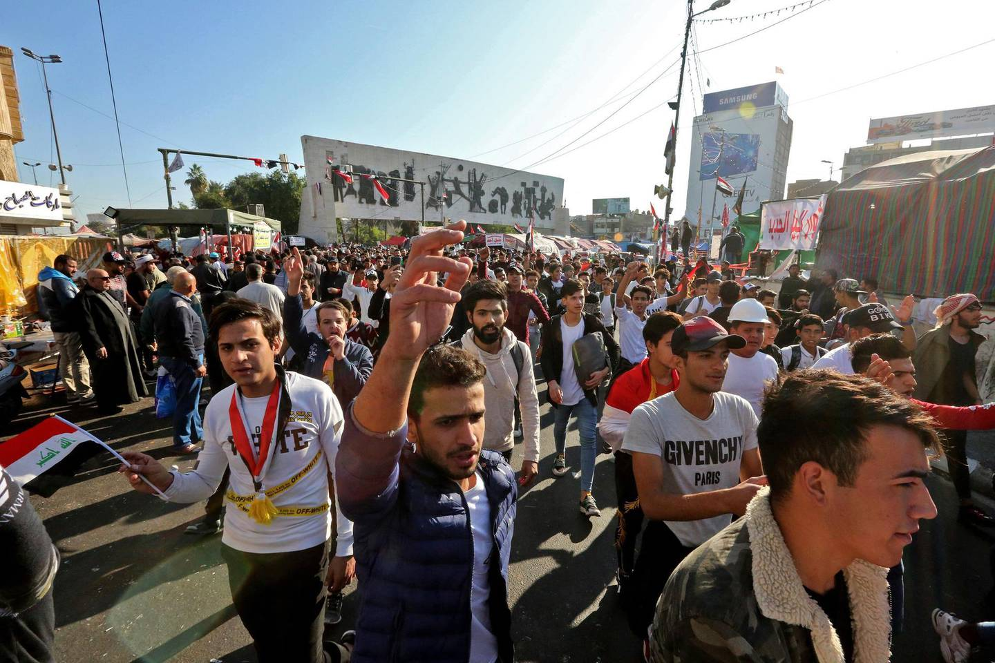 Iraqi anti-government protesters are pictured at Tahrir square on November 19, 2019. Protests erupted in early October in fury over corruption, a lack of jobs and an out-of-touch political class. / AFP / SABAH ARAR