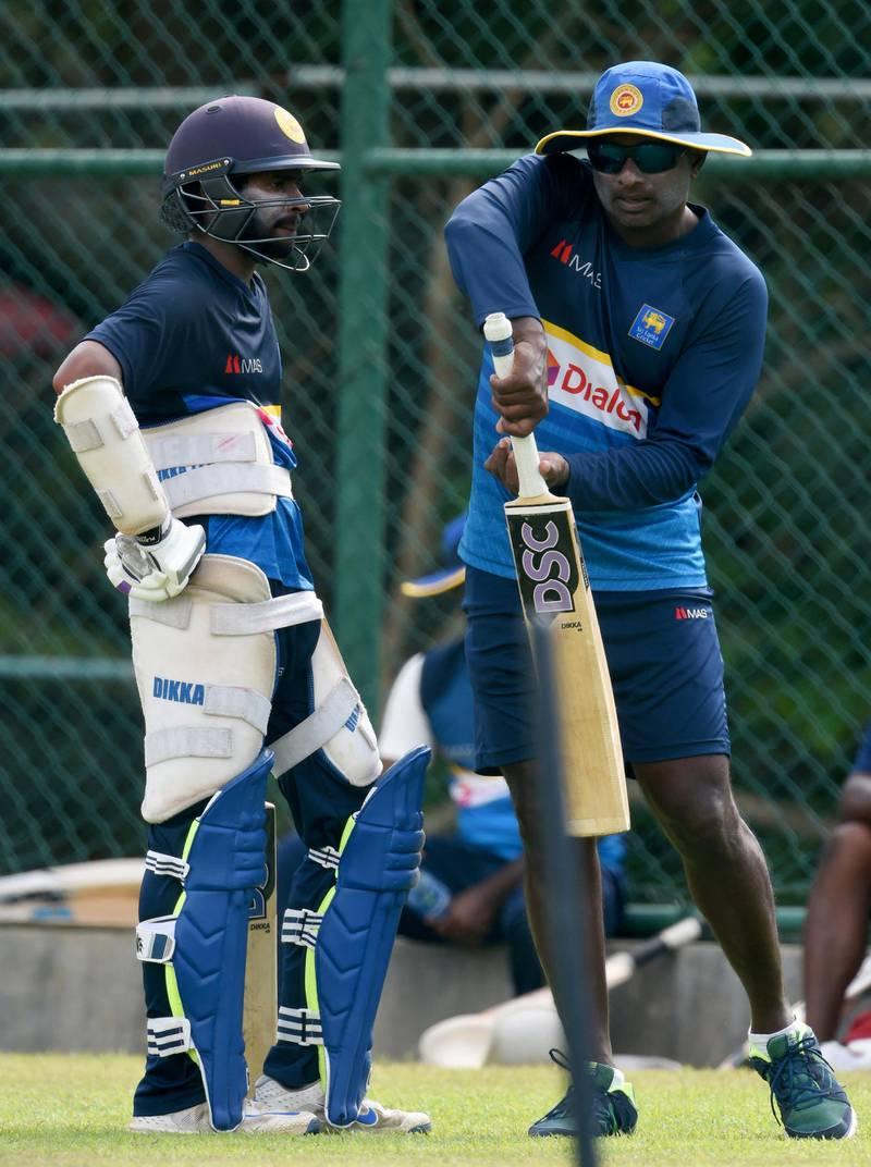 Sri Lankan cricket batting coach Avishka Gunawardene (R) instructs player Niroshan Dickwella during a practice session at the Pallekele International Cricket Stadium in Pallekele on August 23, 2017. - The second one day international (ODI) cricket match between Sri Lanka and India takes place in Pallekele on August 24. (Photo by ISHARA S. KODIKARA / AFP)