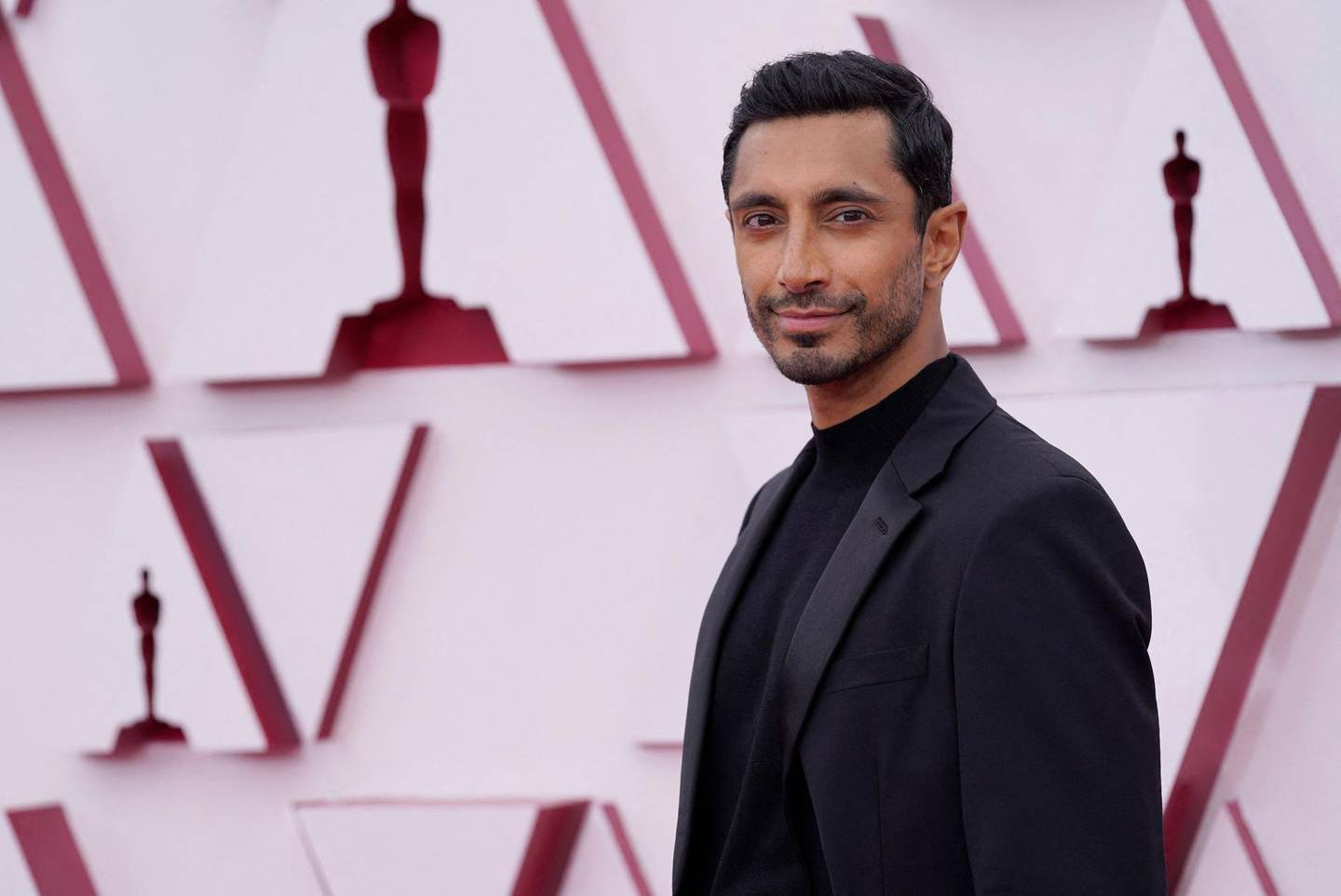"""Riz Ahmed, nominated for an Academy Award for Actor in a Leading Role for his performance in """"Sound of Metal"""" arrives at the Oscars on April 25, 2021, at Union Station in Los Angeles.  -   / AFP / POOL / Chris Pizzello"""