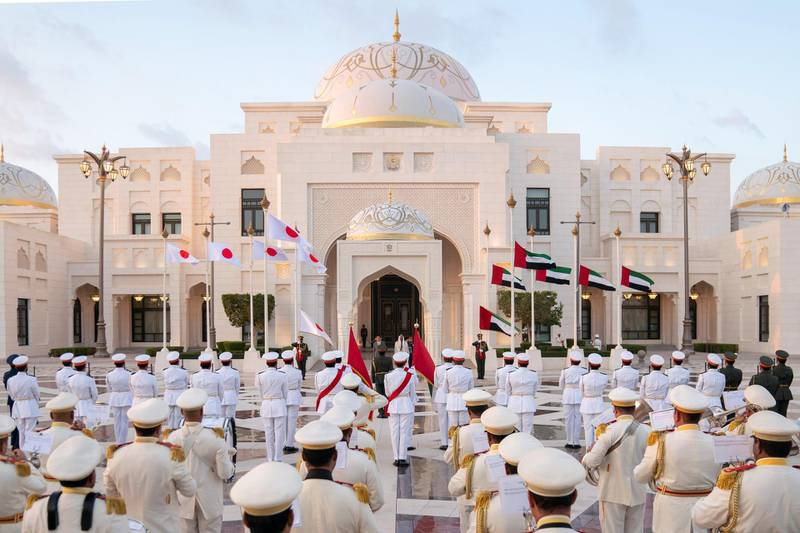 ABU DHABI, UNITED ARAB EMIRATES - January 13, 2020: HH Sheikh Mohamed bin Zayed Al Nahyan, Crown Prince of Abu Dhabi and Deputy Supreme Commander of the UAE Armed Forces (center R) and HE Shinzo Abe, Prime Minister of Japan (center L), stand for the national anthem during a reception at Qasr Al Watan.  ( Eissa Al Hammadi for the Ministry of Presidential Affairs ) ---