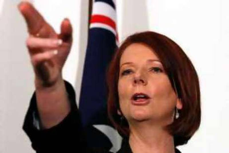 CANBERRA, AUSTRALIA - JUNE 24:  Australian Prime Minister Julia Gillard gestures during a press conference following the Labour leadship spill which saw Gillard call a leadership ballot for the role of Prime Minister at Parliament House on June 24, 2010 in Canberra, Australia. Gillard demanded the ballot as party support for current PM Kevin Rudd collapsed. However no votes were cast in the caucus held this morning at 09:00 AEST, as Rudd conceded and stood down, making Gillard Australia's first female Prime Minister, with current treasurer Wayne Swan moving into the role of Deputy.  (Photo by Scott Barbour/Getty Images) *** Local Caption ***  GYI0060851635.jpg