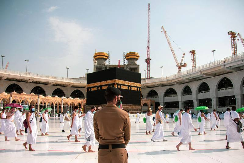 """A handout picture provided by Saudi Ministry of Media on July 31, 2020 shows pilgrims circumambulating around the Kaaba, the holiest shrine in the Grand mosque in the holy Saudi  city of Mecca. - Muslim pilgrims converged today on Saudi Arabia's Mount Arafat for the climax of this year's hajj, the smallest in modern times and a sharp contrast to the massive crowds of previous years. (Photo by - / Saudi Ministry of Media / AFP) / === RESTRICTED TO EDITORIAL USE - MANDATORY CREDIT """"AFP PHOTO / HO / SAUDI MINISTRY OF MEDIA"""" - NO MARKETING NO ADVERTISING CAMPAIGNS - DISTRIBUTED AS A SERVICE TO CLIENTS ==="""