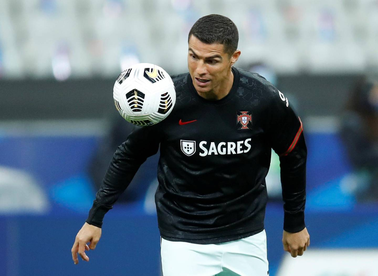 FILE PHOTO: Soccer Football - UEFA Nations League - League A - Group 3 - France v Portugal - Stade De France, Paris, France - October 11, 2020 Portugal's Cristiano Ronaldo during the warm up before the match REUTERS/Gonzalo Fuentes/File Photo