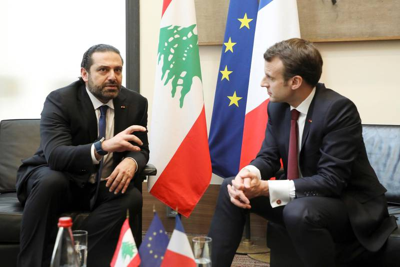 Lebanese Prime Minister Saad Hariri, left, speaks with French President Emmanuel Macron as they attend the international CEDRE conference in Paris Friday, April 6, 2018.International donors are set to give the green light to a $10-billion investment plan for Lebanon at the conference in Paris, hoping to stave off an economic crisis. Lebanon's economic growth has plummeted due to repeated political crises, compounded by the Syrian war which has sent a million refugees across the border -- equivalent to a quarter of the Lebanese population before the conflict. (Ludovic Marin / pool photo via AP)