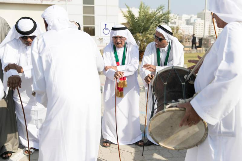 FUJAIRAH, UNITED ARAB EMIRATES - NOV 28:  A musical band dances outside the National Media Council offices in Fujairah as part of the UAE National Day celebrations.  Al Fujairah began it's UAE National Day celebrations with a national parade.  (Photo by Reem Mohammed/The National)  Reporter:  Ruba Haza Section: NA