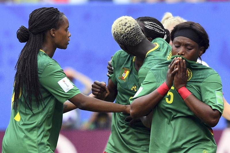 Cameroon's players react after their goal was disallowed for offside during the France 2019 Women's World Cup round of sixteen football match between England and Cameroon, on June 23, 2019, at the Hainaut stadium in Valenciennes, northern France. (Photo by Philippe HUGUEN / AFP)
