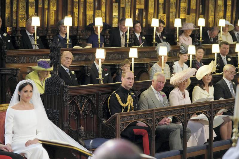 WINDSOR, UNITED KINGDOM - MAY 19:  Meghan Markle in St George's Chapel, Windsor Castle for her wedding to Prince Harry watched by (middle row from left) Queen Elizabeth II, Duke of Edinburgh, Earl of Wessex, Viscount Severn, Countess of Wessex, Lady Louise Mountbatten-Windsor, Princess Royal, Sir Tim Laurence, (front row from left) Duke of Cambridge, Prince of Wales, Duchess of Cornwall Duchess of Cambridge, Duke of York during her wedding in St George's Chapel at Windsor Castle on May 19, 2018 in Windsor, England. (Photo by Jonathan Brady - WPA Pool/Getty Images)
