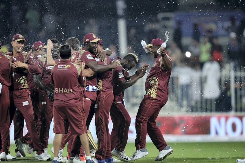 Sharjah, United Arab Emirates - December 02, 2018: Warriors celebrates winning the trophy after the game between between Pakhtoons and Northern Warriors in the T10 final. Sunday the 2nd of December 2018 at Sharjah cricket stadium, Sharjah. Chris Whiteoak / The National