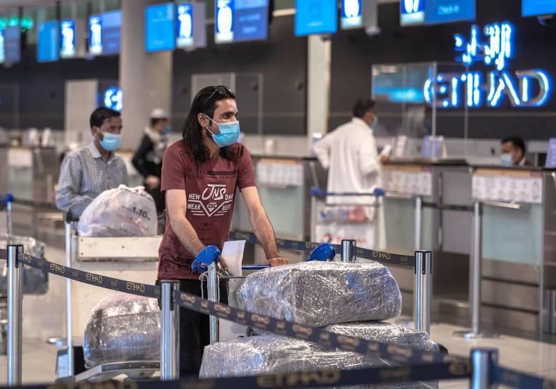 Abu Dhabi, United Arab Emirates, July 8, 2020.   Abu Dhabi International Airport Media Tour by Etihad.  Passengers at the Etihad Check-In area.Victor Besa  / The NationalSection:  NA Reporter: