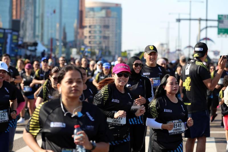 Abu Dhabi, United Arab Emirates - December 06, 2019: Athletes run the 5K the ADNOC Abu Dhabi marathon 2019. Friday, December 6th, 2019. Abu Dhabi. Chris Whiteoak / The National