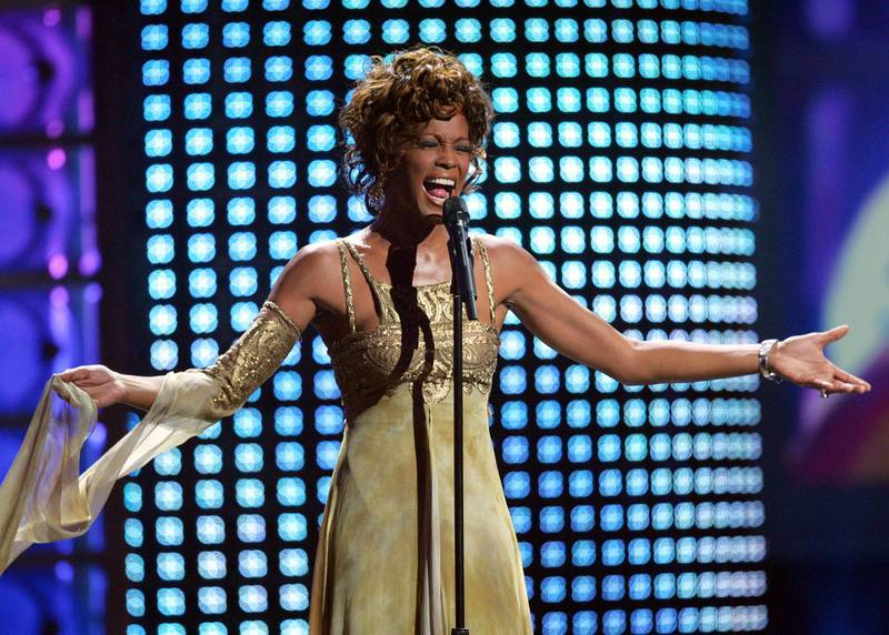 """FILE - In this Sept. 15, 2004 file photo, recording artist Whitney Houston performs at the 2004 World Music Awards at the Thomas and Mack Arena in Las Vegas. Houston is about to appear on the concert stage again. Eight years after her death, five years after the show was conceived and a year after production began, a holographic Houston will embark on a European tour starting Feb. 25, with U.S. dates expected to follow. The singer's sister-in-law and former manager Pat Houston says it's the right time for a revival, and says it's a show Whitney Houston would've wanted. The concerts will feature a projected Houston performing most of her biggest hits, including """"I Will Always Love You,"""" with real backup dancers and a live band. (AP Photo/Eric Jamison, file)"""