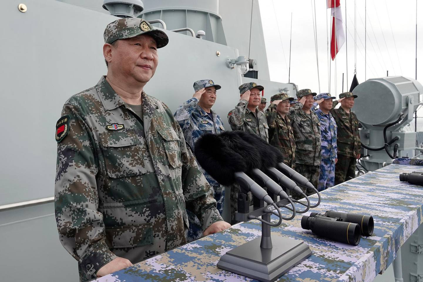 FILE - In this April 12, 2018, file photo released by Xinhua News Agency, Chinese President Xi Jinping, left, speaks after he reviewed the Chinese People's Liberation Army (PLA) Navy fleet in the South China Sea. From Asia to Africa, London to Berlin, Chinese envoys have set off diplomatic firestorms with a combative defense whenever their country is accused of not acting quickly enough to stem the spread of the coronavirus pandemic. (Li Gang/Xinhua via AP, File)