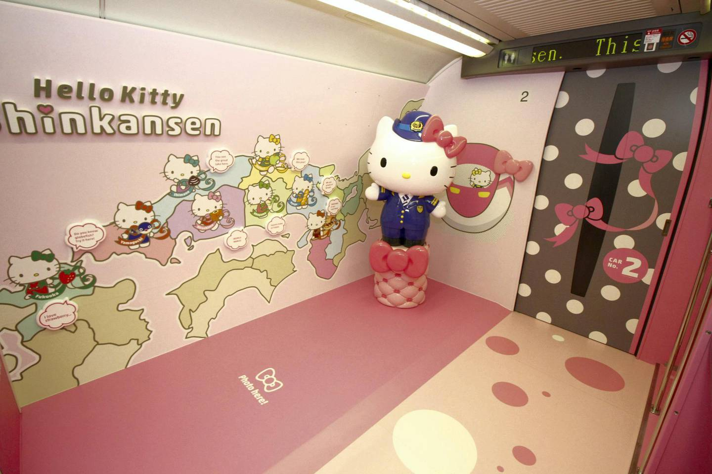 """This handout picture taken on June 25, 2018 and released by West Japan Railway on June 26, 2018 shows a photo spot inside a Shinkansen train for passengers to pose with popular character Hello Kitty, as seen at the Hakata car maintenance center in Fukuoka prefecture. Resplendent in shocking pink, a sleek """"Hello Kitty"""" bullet train, complete with special carriages festooned with images of the global icon from Japan, has been unveiled before chugging into service this week starting June 25. / AFP PHOTO / West Japan Railway / Handout / -----EDITORS NOTE --- RESTRICTED TO EDITORIAL USE - MANDATORY CREDIT """"AFP PHOTO / West Japan Railway"""" - NO MARKETING - NO ADVERTISING CAMPAIGNS - DISTRIBUTED AS A SERVICE TO CLIENTS - NO ARCHIVES"""