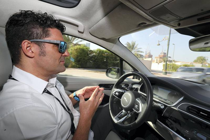 Dubai, United Arab Emirates - October 15, 2019: A Jaguar I Pace autonomous vehicle driven by Jim O'Donoghue, lead research engineer takes people on a drive to show driverless cars at work at the Dubai World Congress for Self-Driving Transport. Tuesday the 15th of October 2019. World Trade centre, Dubai. Chris Whiteoak / The National