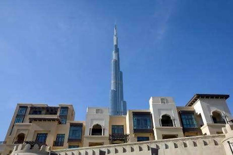 Dubai - November 19, 2009 - The Burj Dubai rises above The Old Town Island near Dubai Mall in Dubai November 19, 2009. STOCK  (Photo by Jeff Topping/The National) *** Local Caption ***  JT001-1119-BURJ DUBAI STOCK_MG_3106.jpg