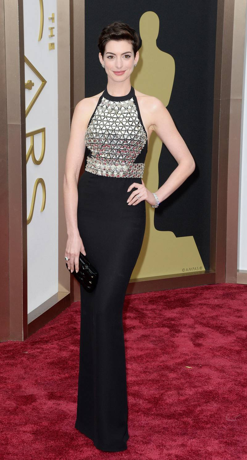 epa04107228 US actress Anne Hathaway arrives for the 86th annual Academy Awards ceremony at the Dolby Theatre in Hollywood, California, USA, 02 March 2014. The Oscars are presented for outstanding individual or collective efforts in up to 24 categories in filmmaking.  EPA/MIKE NELSON
