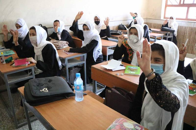 epa08619509 Afghan student girls attend the second day of their school after the educational institutes opened in Herat, Afghanistan, 23 August 2020. Schools reopen across Afghanistan, in a trial following months of closure due to the pandemic.  EPA/JALIL REZAYEE