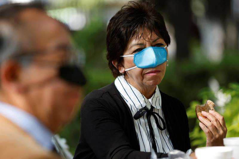 Ana Maria Gonzalez wears a new innovation, a nasal mask designed by Mexican scientist Gustavo Acosta Altamirano, as a measure to protect against the coronavirus disease (COVID-19) transmission during the process of eating and drinking at the National Polytechnic Institute, in Mexico City, Mexico March 18, 2021. Picture taken March 18, 2021. REUTERS/Carlos Jasso