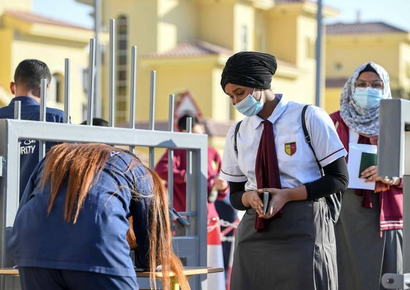 Abu Dhabi, United Arab Emirates - Students having their passports checked by security before exams at Gems Cambridge International School, in Baniyas. Khushnum Bhandari for The National